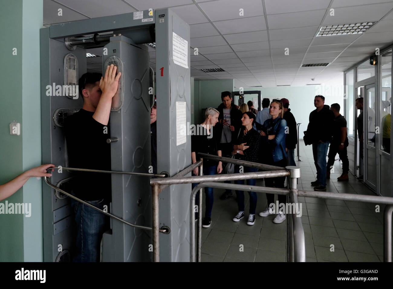 Visitors undergo a radiation control before entering the canteen for lunch at the Chernobyl nuclear site in Ukraine - Stock Image