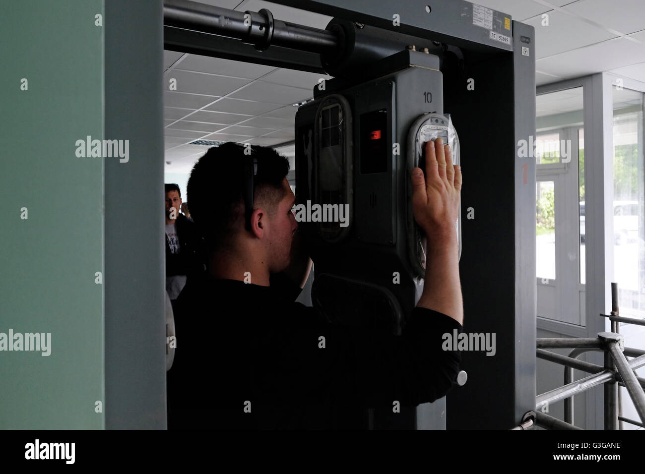 Visitor undergo a radiation control before entering the canteen for lunch at the Chernobyl nuclear site in Ukraine - Stock Image
