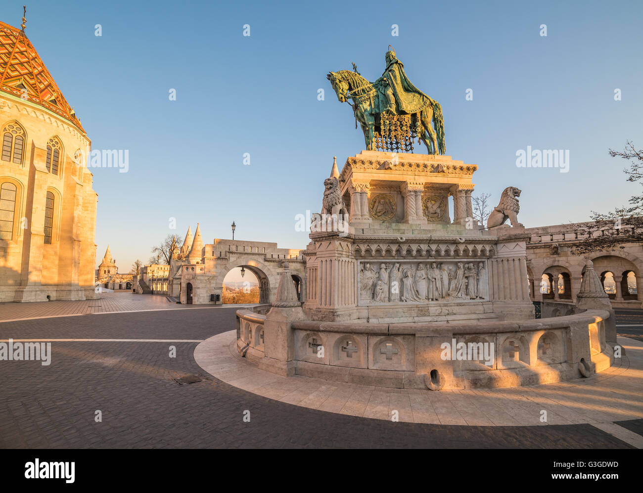 Saint Stefan Statue at Fisherman's Bastion, in Budapest, Hungary with Clear Blue Sky in Background at Sunrise Stock Photo