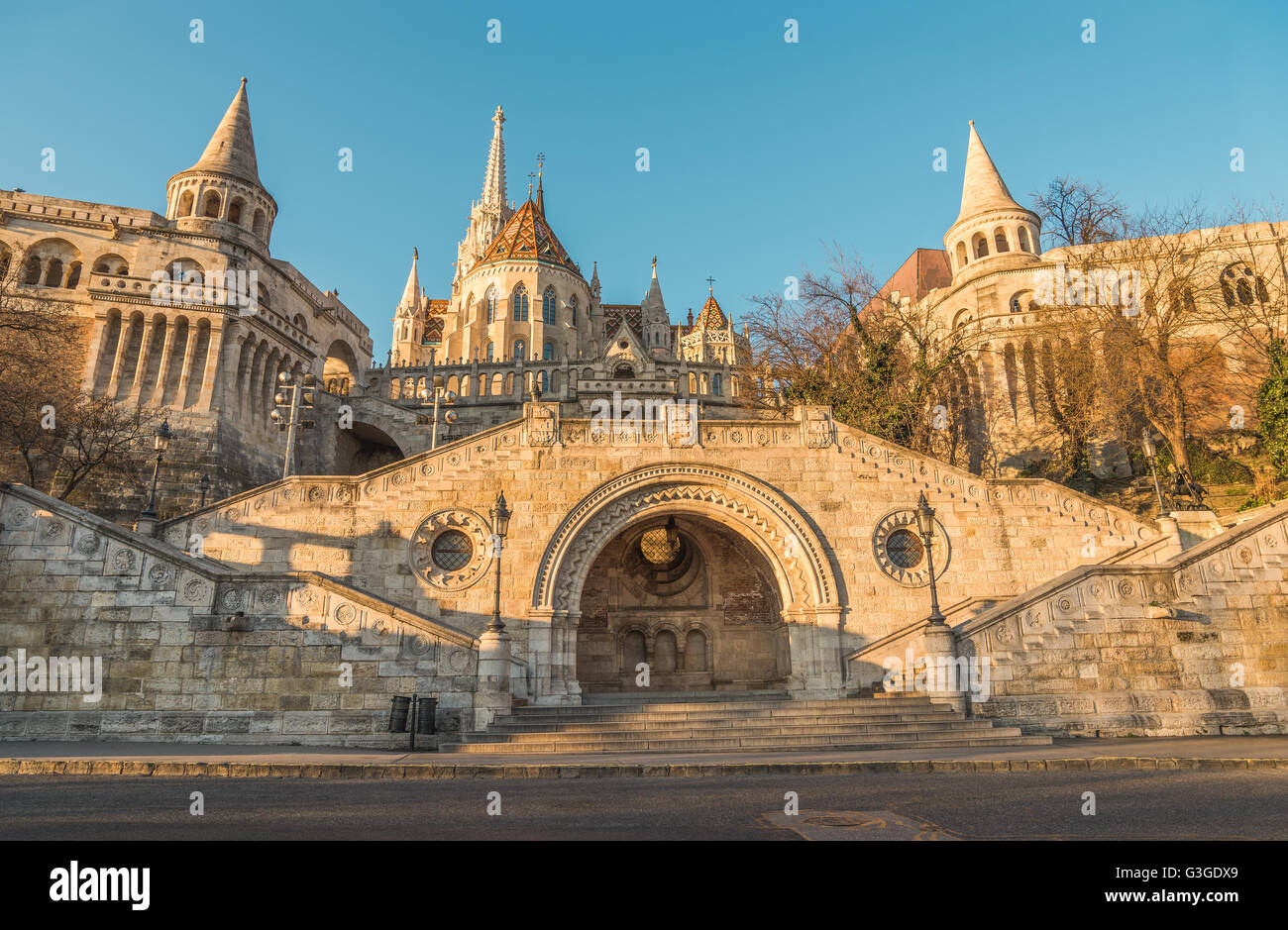 Sunlit Fisherman's Bastion in Budapest, Hungary at Sunrise. View from below. - Stock Image