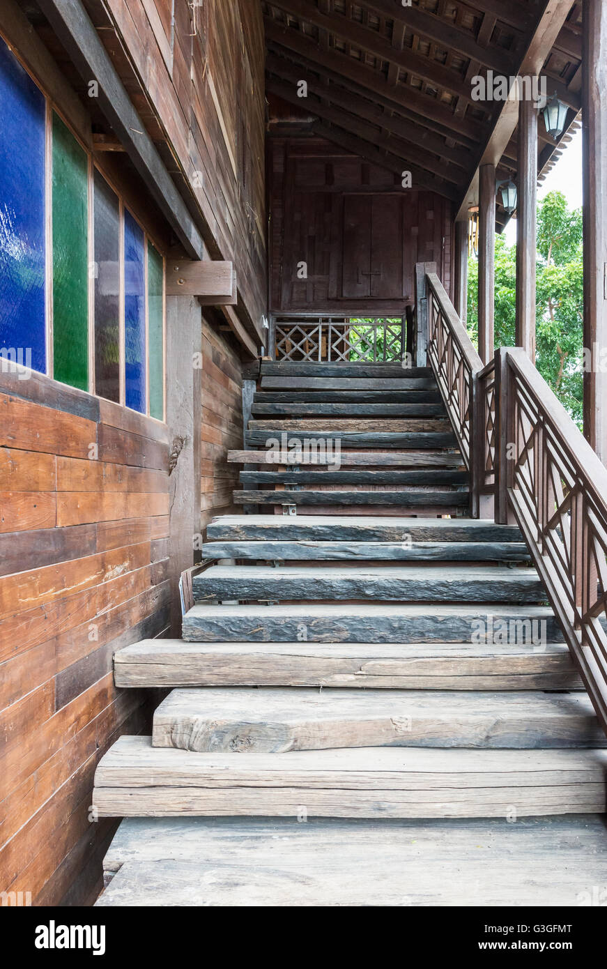 Wooden staircases to the top floor of the old house. - Stock Image