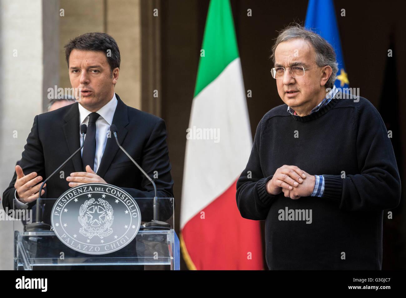 Italian Prime Minister Matteo Renzi (L) and Sergio Marchionne (R), CEO of Fiat Chrysler Automobiles (FCA) attend Stock Photo