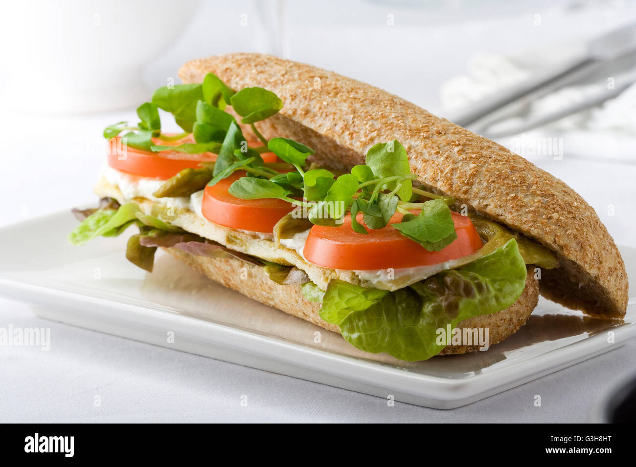 Healthy sandwich with omelet, fresh cheese, tomato and watercress Stock Photo