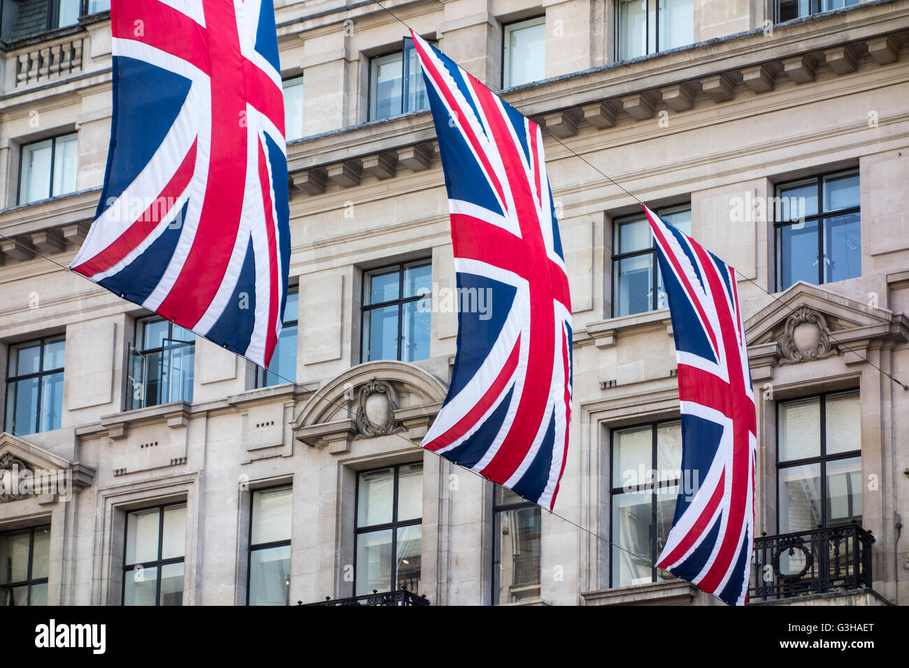 Union Flags / Union Jack Flags hanging over Regent Street, London for the Queen's Birthday - Stock Image