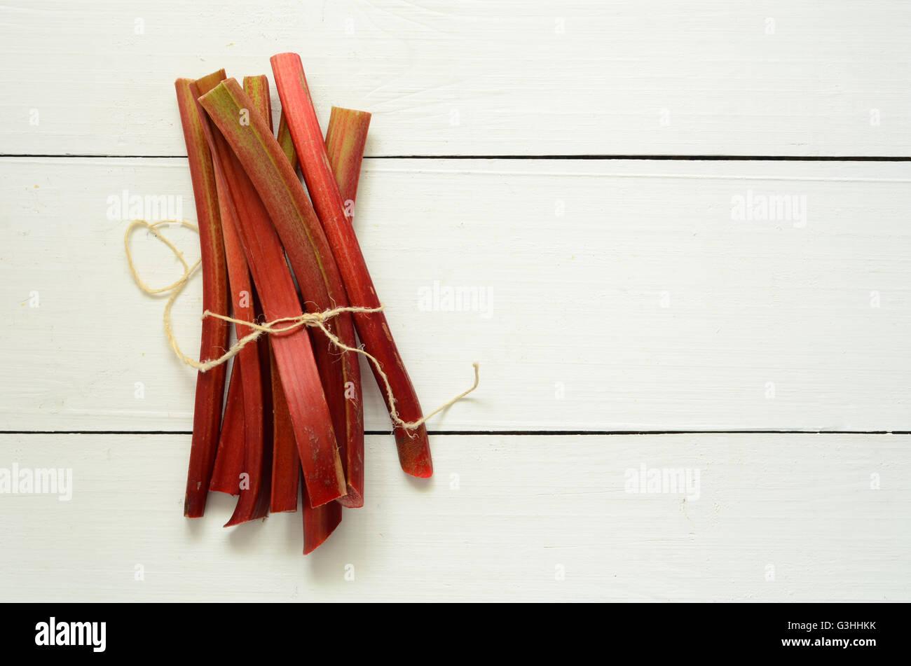 Bunch of fresh picked organic rhubarb stalks - Stock Image