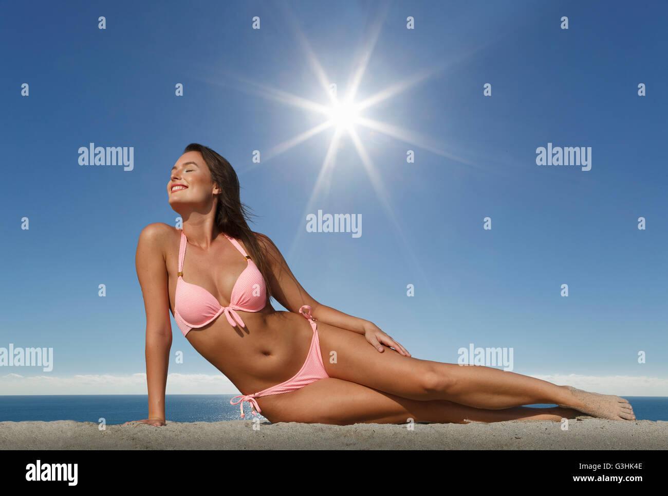 Young woman wearing bikini relaxing on Miami beach, Florida, USA - Stock Image