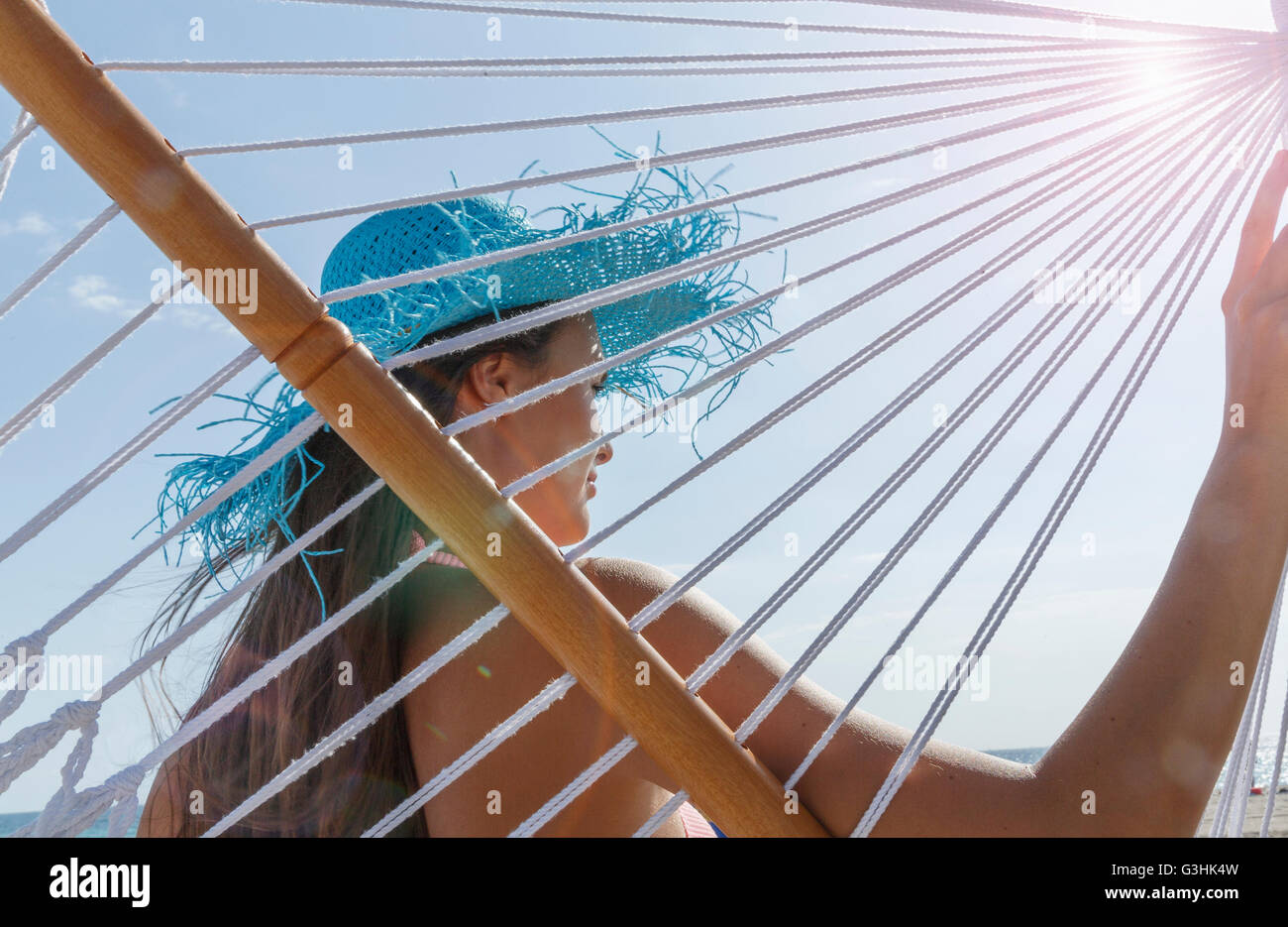 Rear view of young woman on hammock at Miami beach, Florida, USA - Stock Image