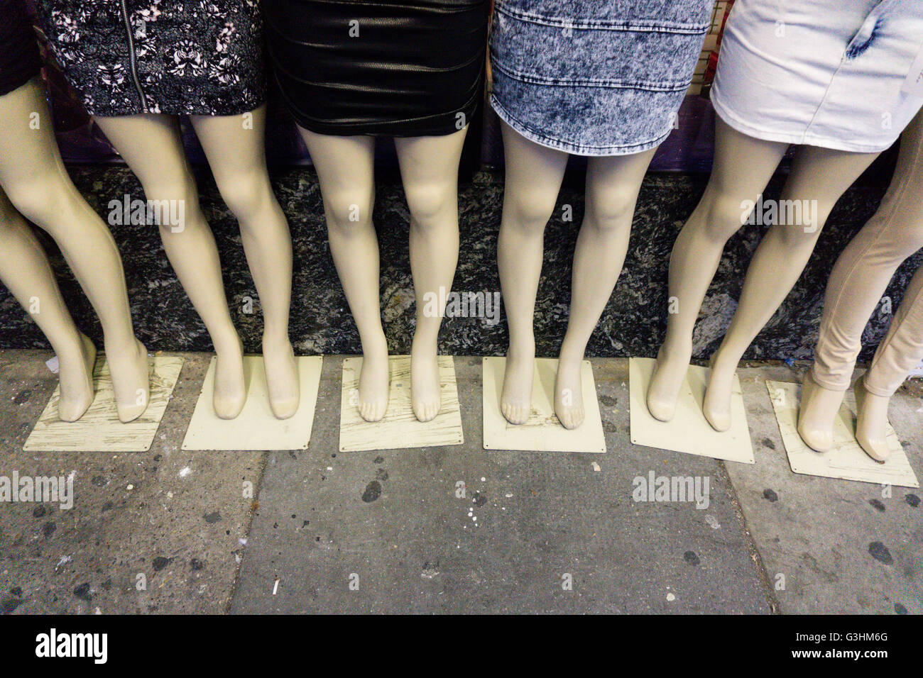 Detail of six female dummies on sidewalk wearing mini skirts Stock Photo