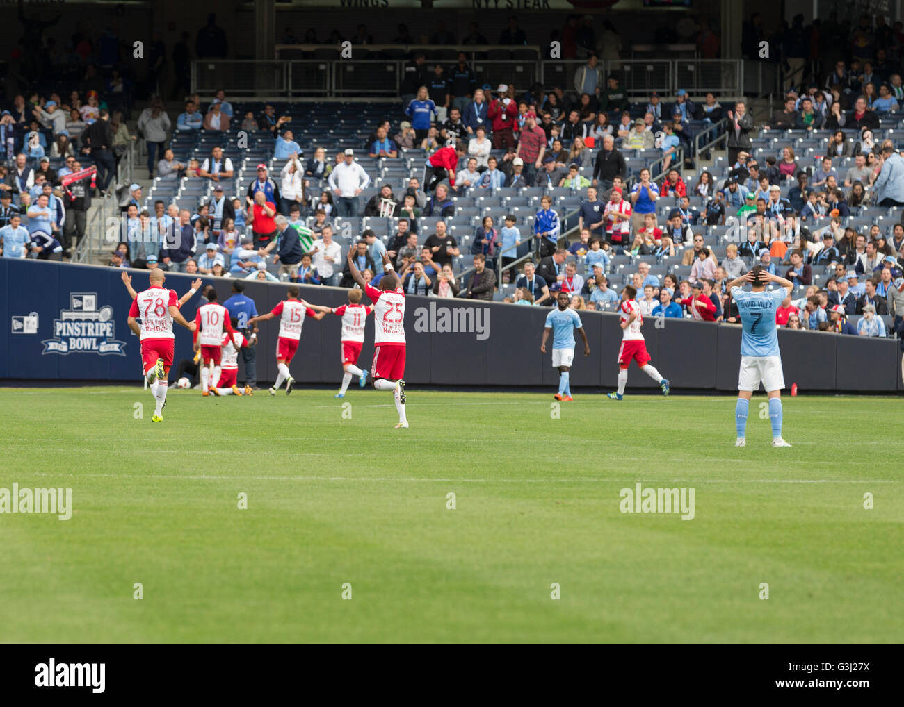 Red Bulls team celebrate 7th goal by Gideon Baah (3) at MLS game NYC FC against Red Bulls at Yankee stadium. Red - Stock Image