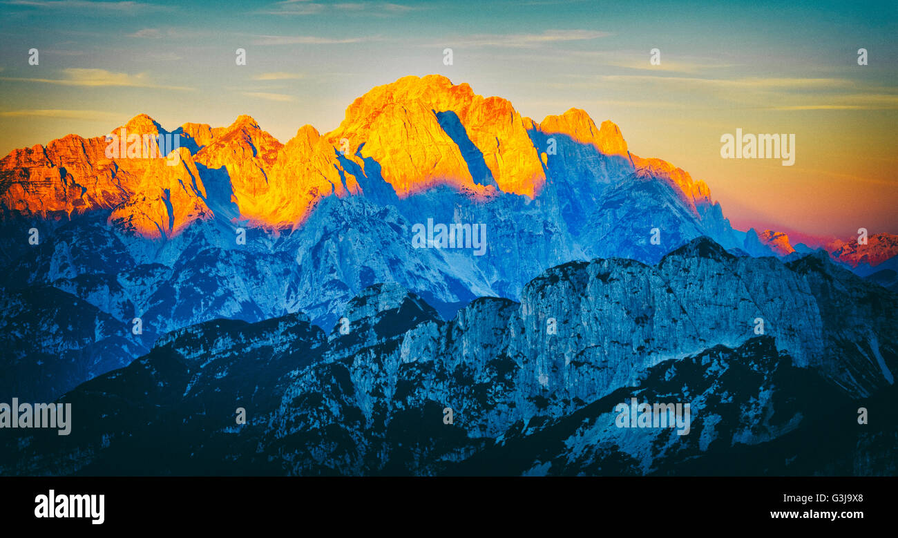 Vintage photo of mountains sunrise.Julian alps, Slovenia - Stock Image