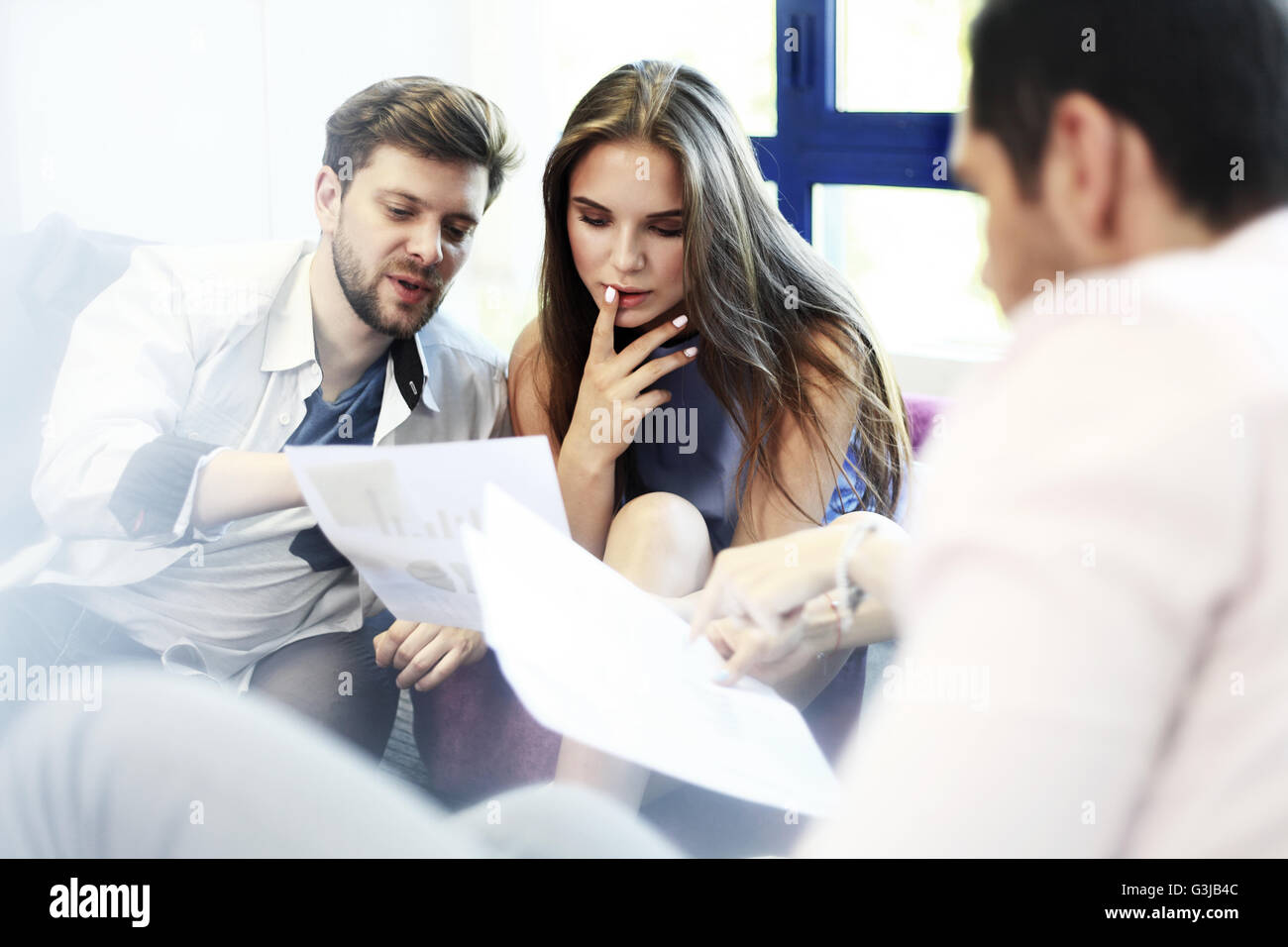 Young professionals work in modern office. - Stock Image