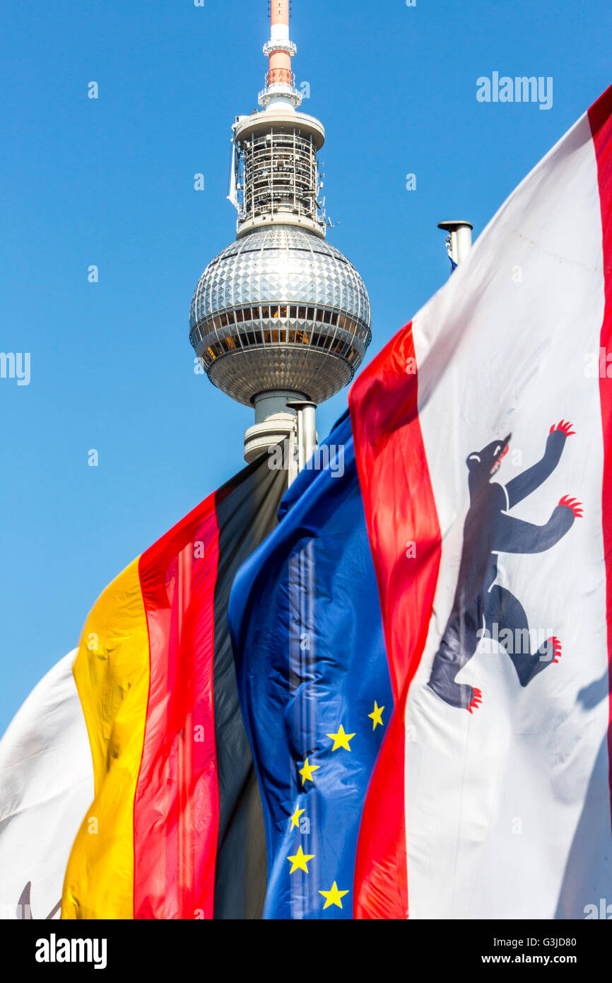 Television Tower in Berlin, Alexander Square, flags of Germany, Europe, Berlin, Stock Photo