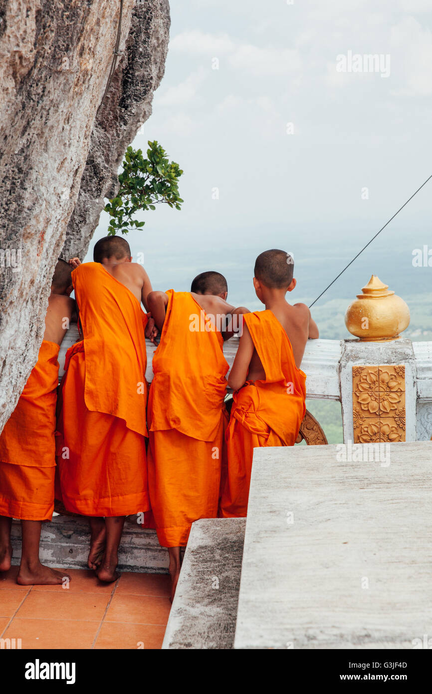Krabi, Thailand - April 10, 2016: Novice monks are observing hilltop of the Tiger Cave Mountain Temple on in Krabi Stock Photo