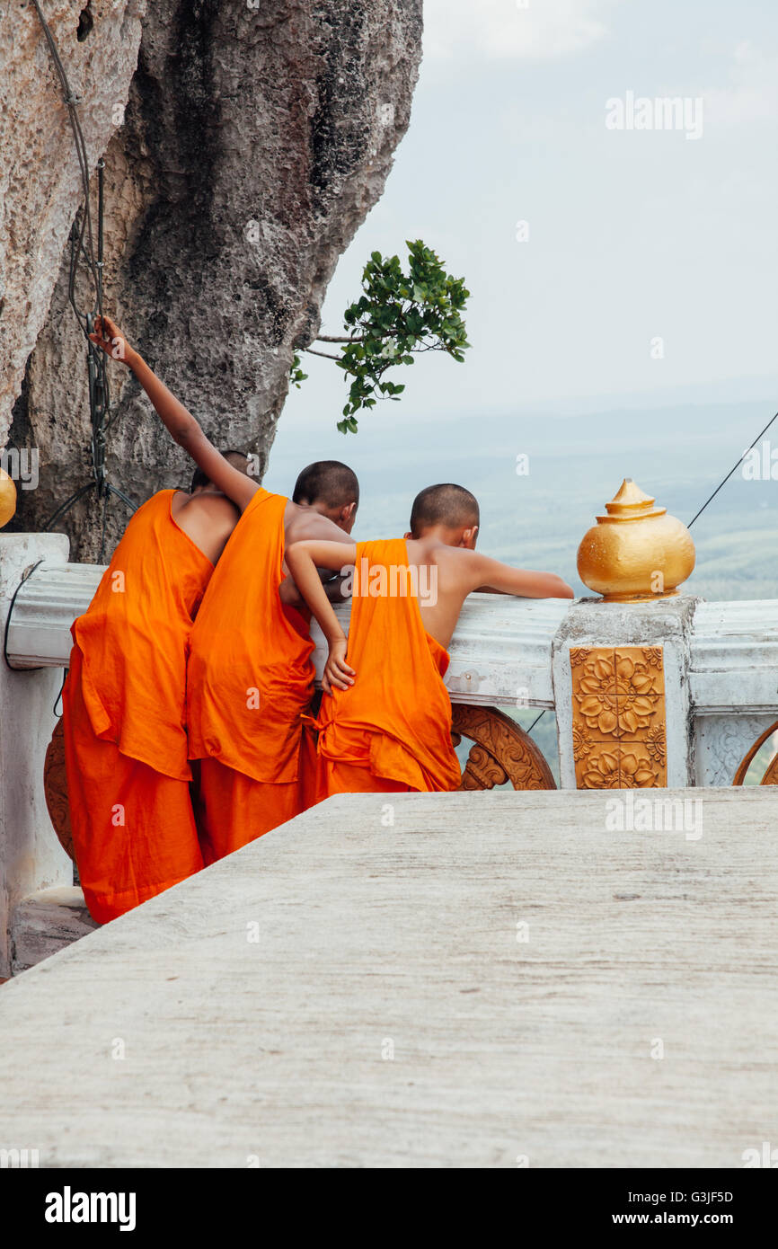 Krabi, Thailand - April 10, 2016: Novice monks are observing hilltop of the Tiger Cave Mountain Temple in Krabi. Stock Photo