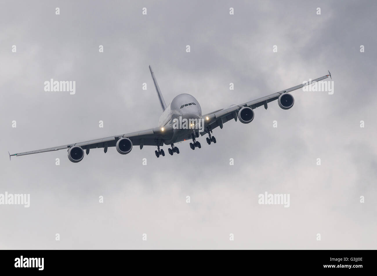 Passenger airliner approaching for landing in bad weather - Stock Image