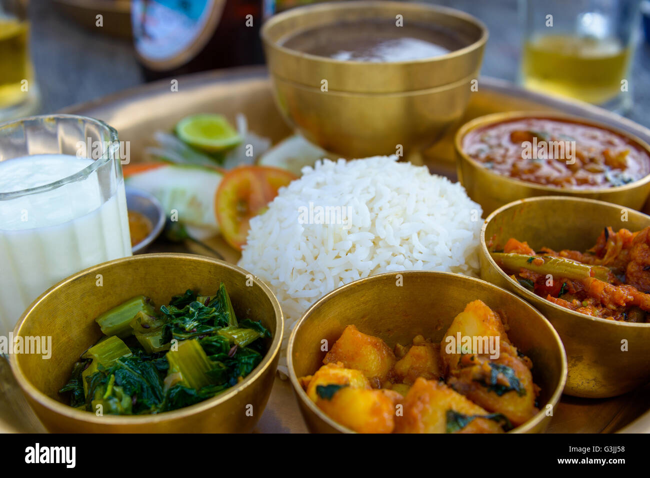 Traditional Nepalese thali in a restaurant - Stock Image