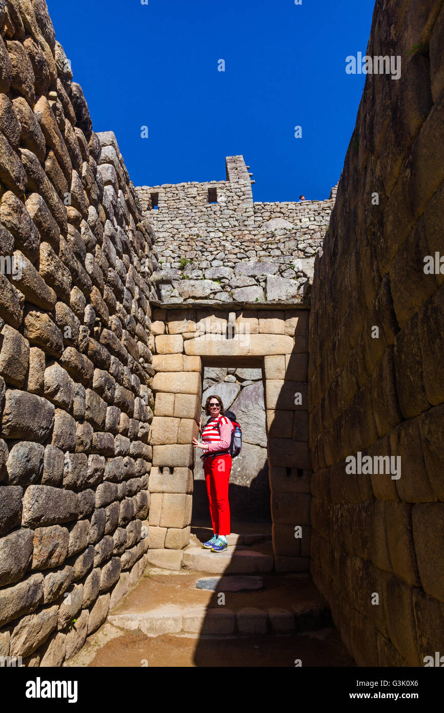 Trapezoidal entry doorway to buildings at Machu Picchu, Peru - Stock Image