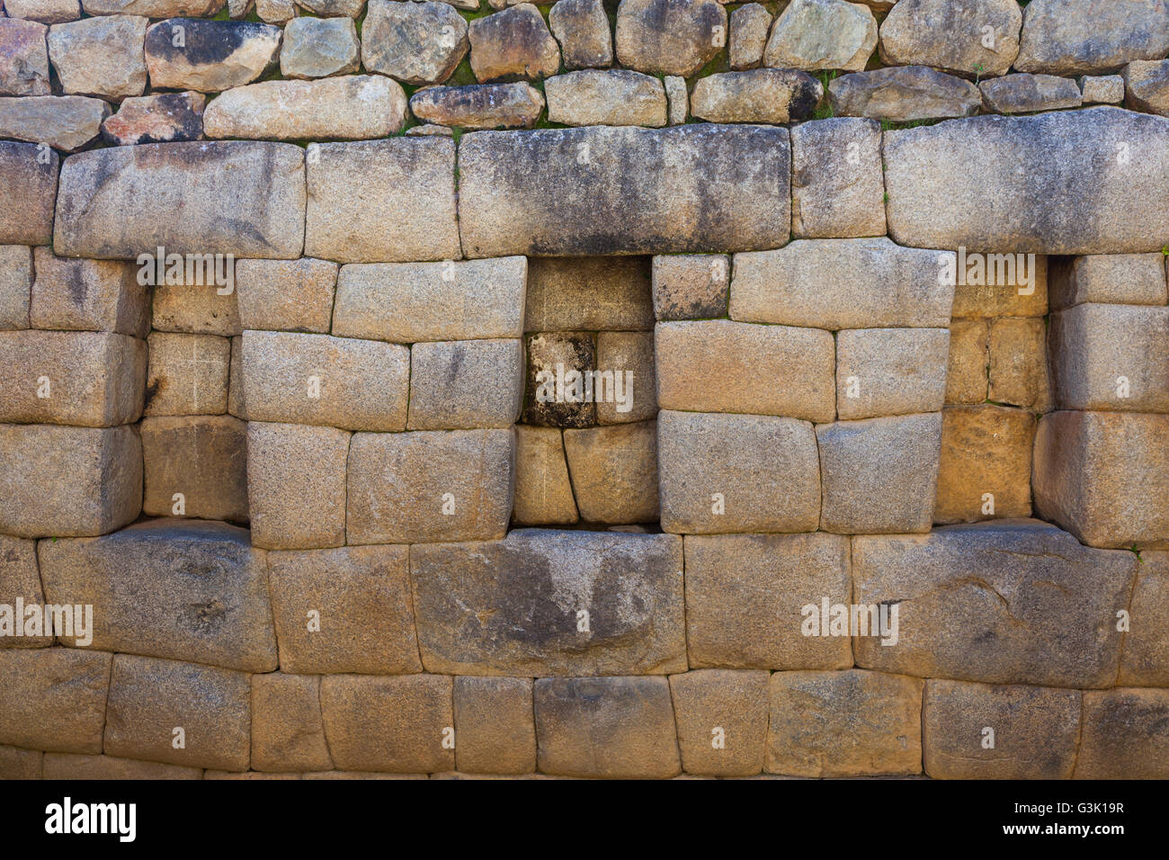 Trapezoidal openings in an internal wall for storage or decor at Machu Picchu, Peru - Stock Image