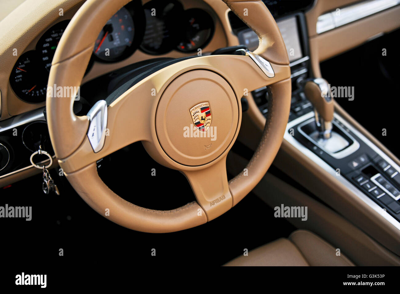 The interior dashboard, steering wheel and console of a Porsche 911 Carrera S - Stock Image