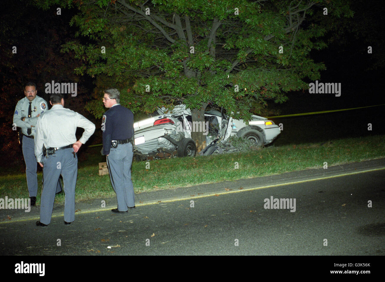 police at the scene of a police car that hit a tree killing the policeman during a high speed chase in Riverdale, - Stock Image