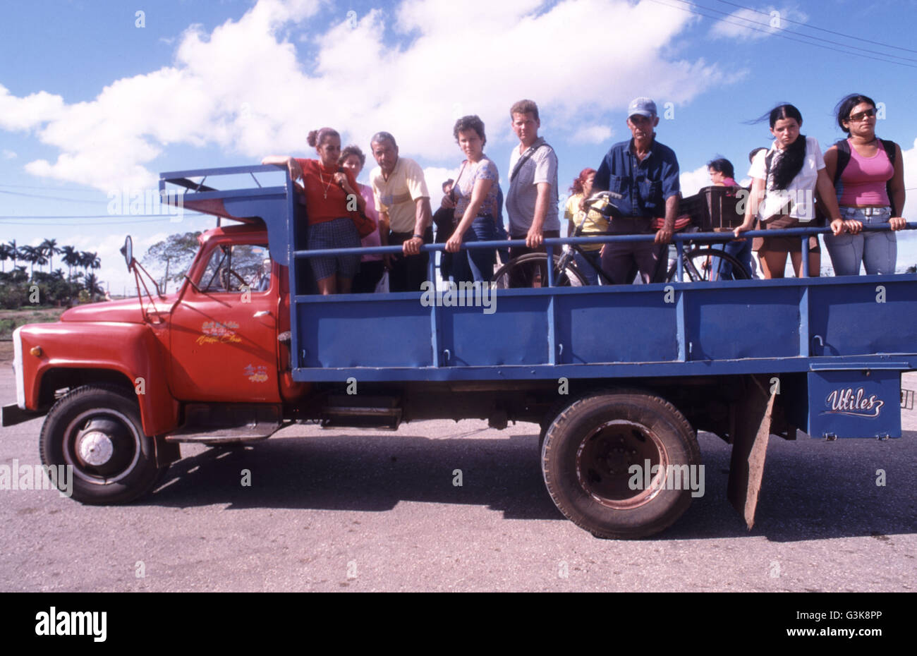 Hitchhikers aboard truck. It is mandatory to pick up hitchhikers in Cuba - Stock Image