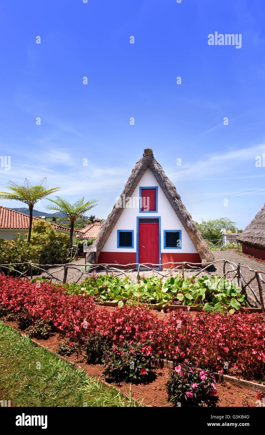 Traditional palheiros - thatched triangular houses in Santana Madeira Stock Photo