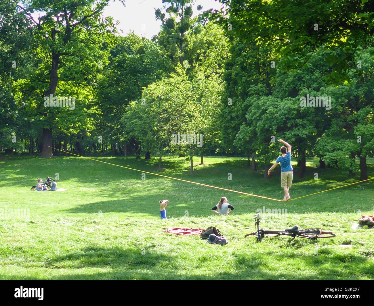 Teenagers slacklining in Prater, Austria, Wien, 02., Wien, Vienna - Stock Image