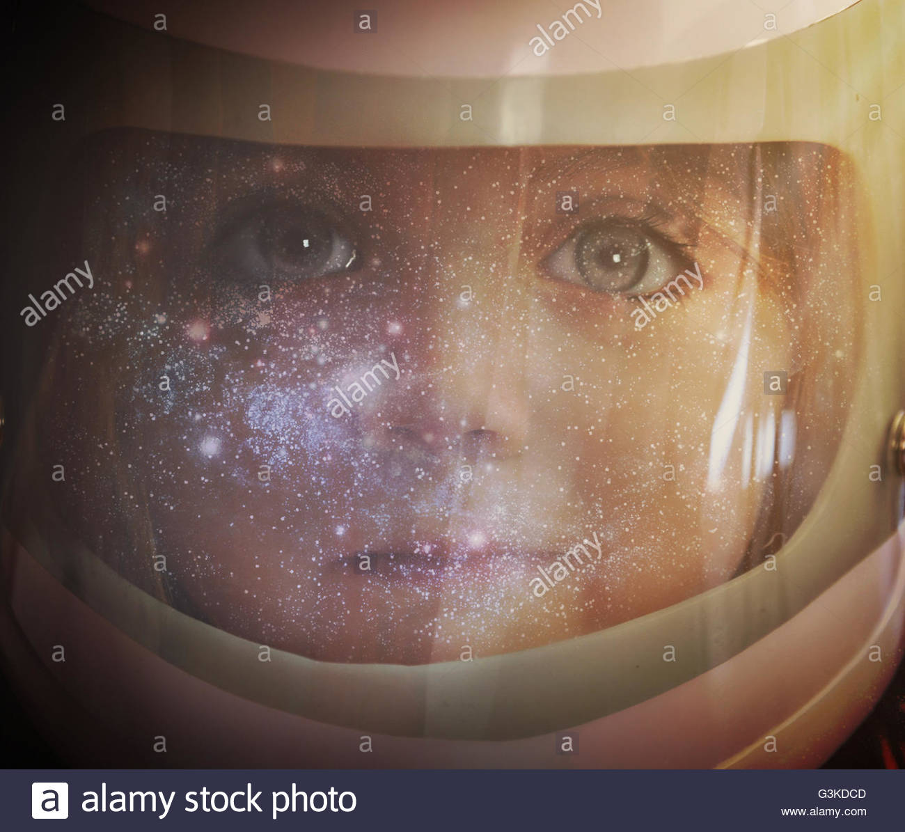 A young girl is wearing an astronaut helmet and looking into space with stars for an education, science or imagination - Stock Image