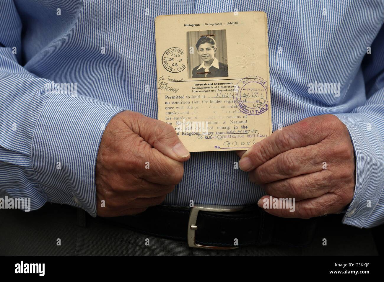 Previously unissued photo dated 25/5/2016 of Holocaust survivor Zigi Shipper holds his entry passport from 1946 - Stock Image