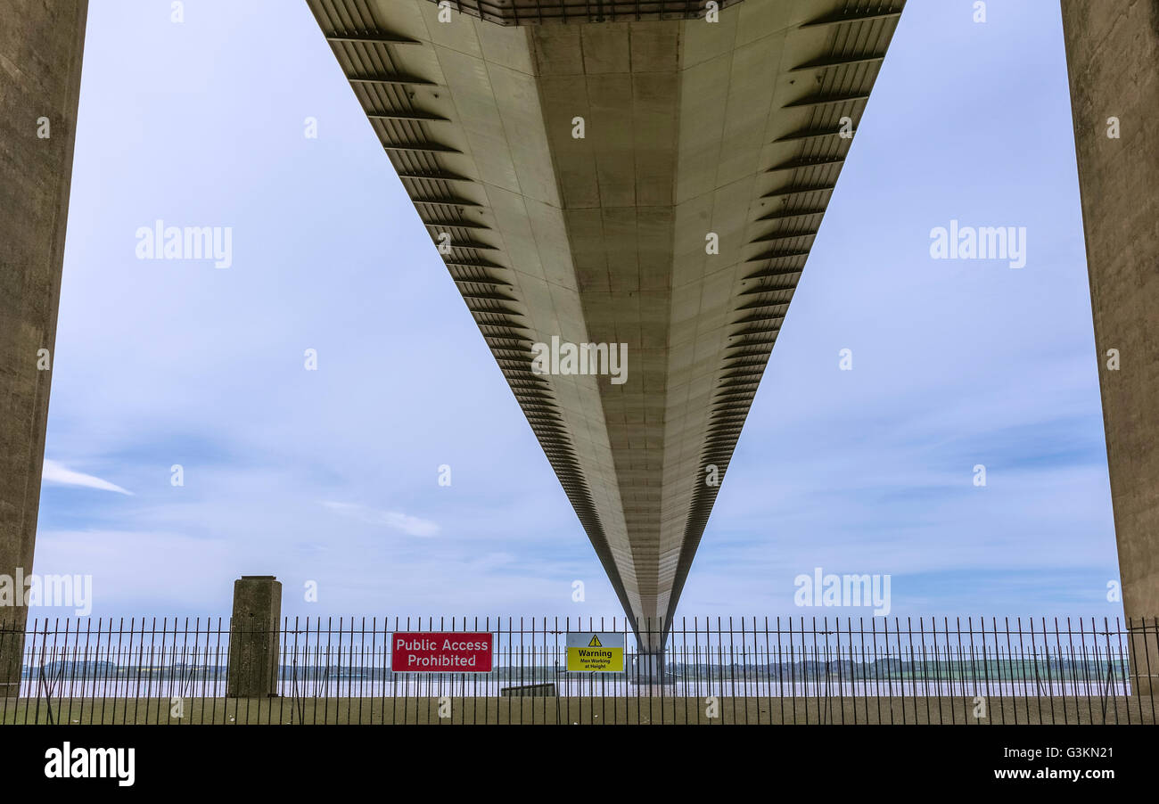 The Humber Bridge as viewed from the underside of the bridge on a bright, overcast summer day near Hessle, Yorkshire, - Stock Image
