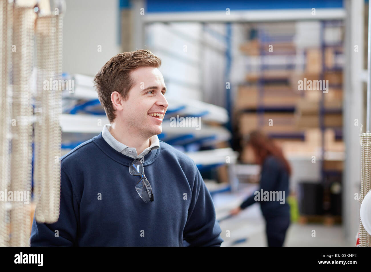 Mid adult male worker in manufacturing factory - Stock Image