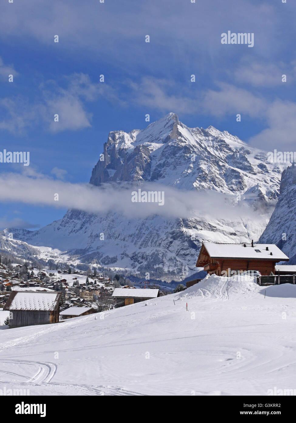 Old ski chalets on the piste between Kleine Scheidegg and Grindlewald - Stock Image
