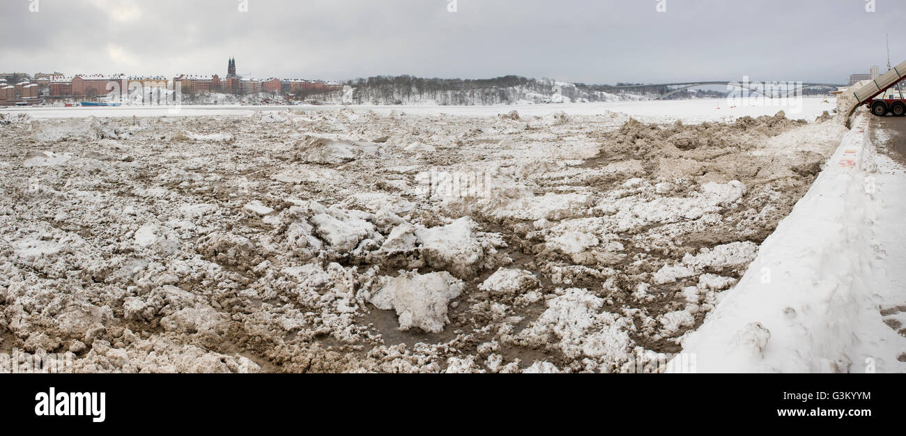 Dumping of snow in the water, Stockholm, Sweden, Europe - Stock Image