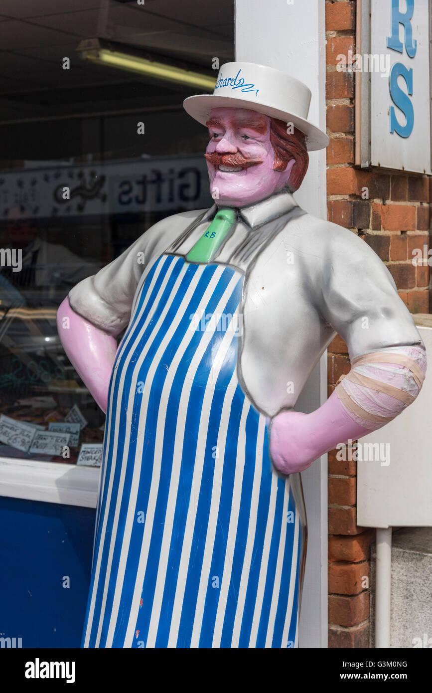 A model of a butcher outside a butchers shop in Hunstanton