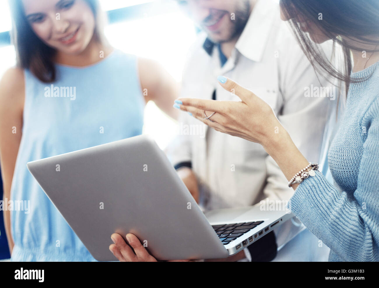 Project manager team discussing new idea.Business crew working with startup. Laptop, showing presentation, monitor.Blurred,film - Stock Image