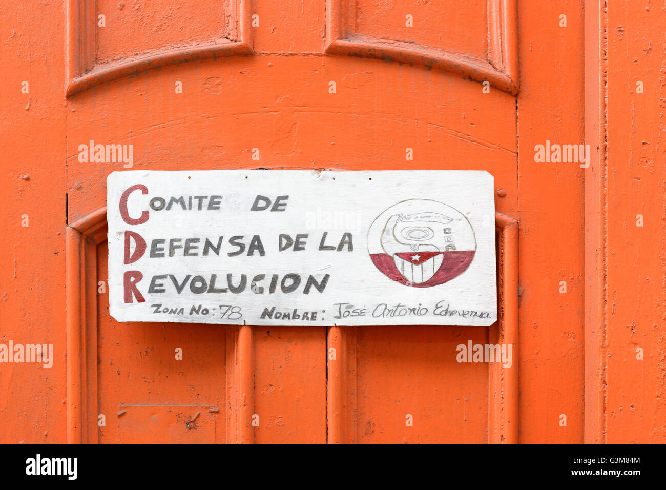 Hand-made sign on an orange door for a local neighbourhood 'Committee for the Defence of the Revolution' - Stock Image