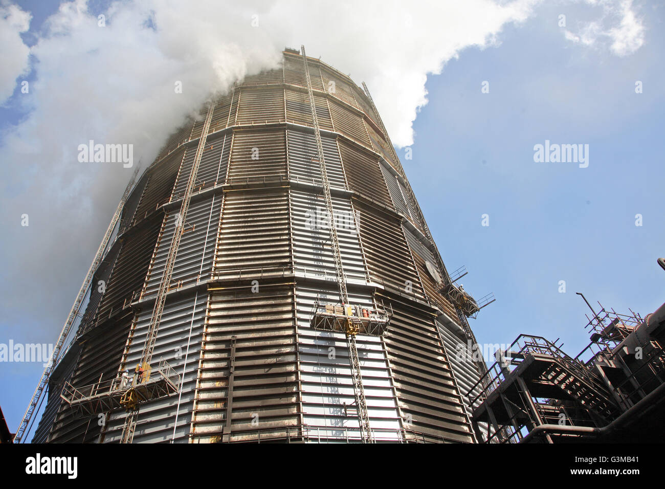 Steam engulfs the top of a steel gas holder at Redcar Steelworks. Taken in 2008 before closure of the plant. - Stock Image