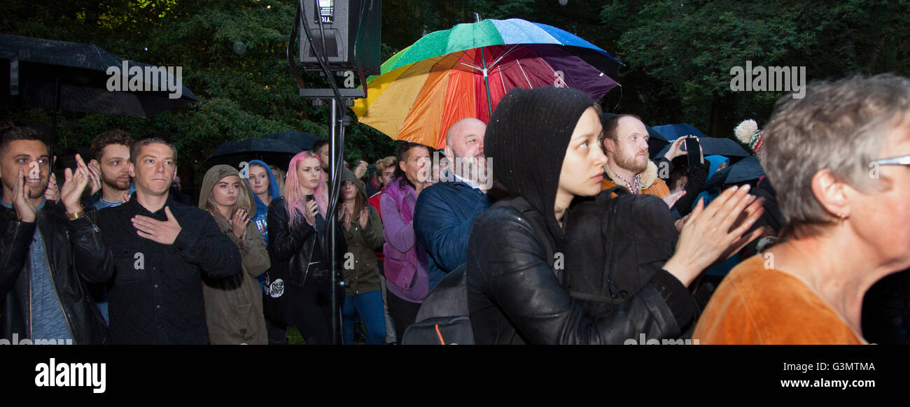 Manchester, UK 13th June, 2016 At the vigil in Sackville Gardens people show their respect and support for the victims - Stock Image