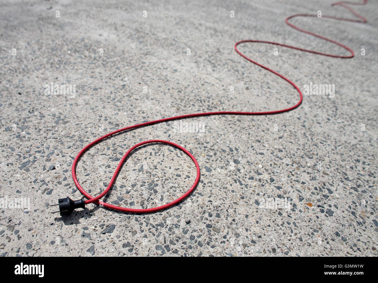 Symbolic image - A red electric cable behind a BMW i3 electric car ...