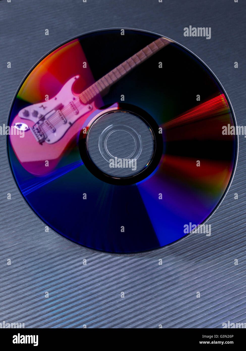 Electric guitar in a Compact disc - Stock Image