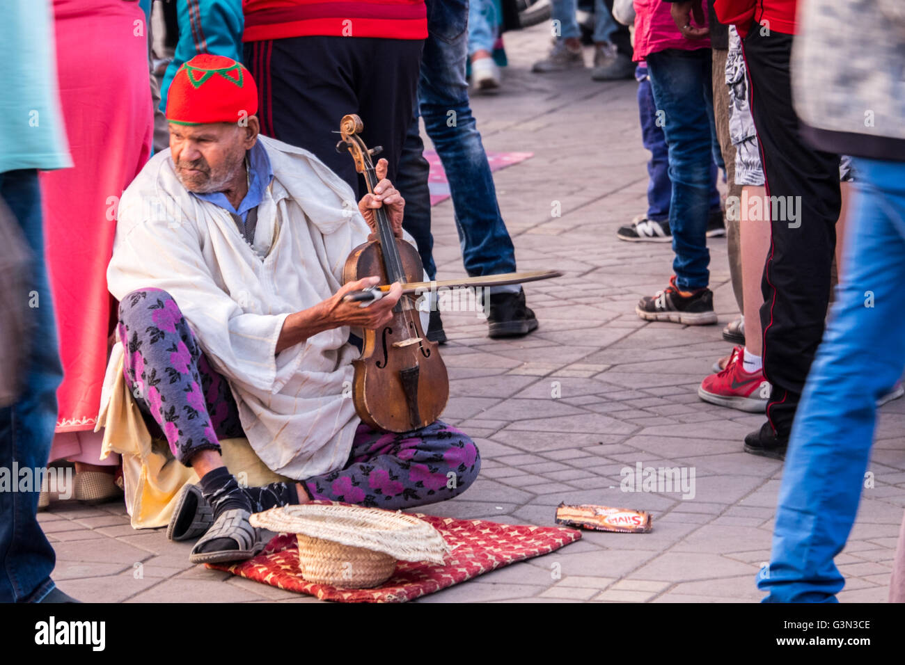 Street entertainer in Jamaa el Fna (Jemaa el-Fnaa, Djema el-Fna  ) the main square in Marrakesh's medina, Morocco - Stock Photo