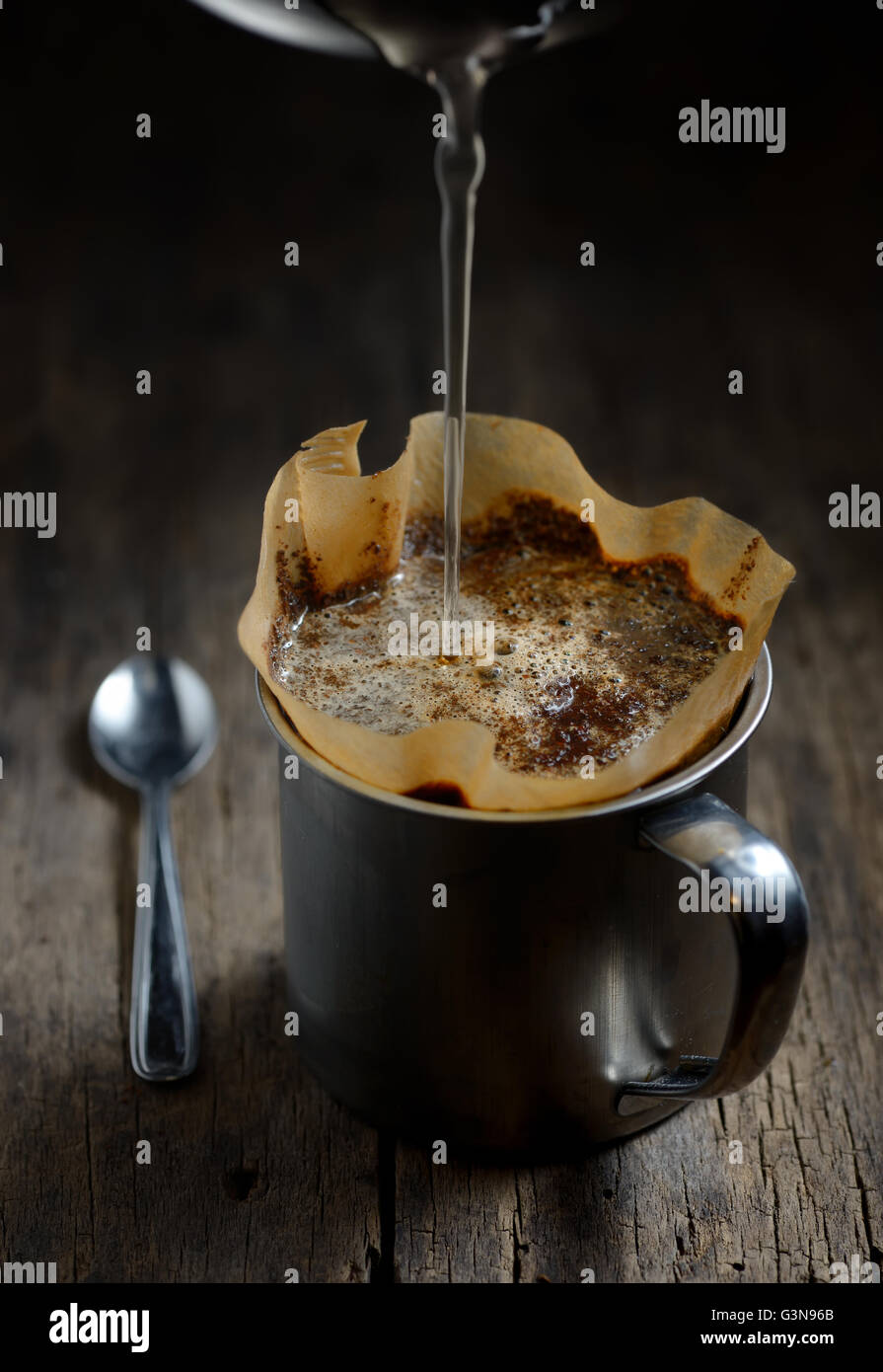 Ground coffee in metal cup and filter holder Stock Photo