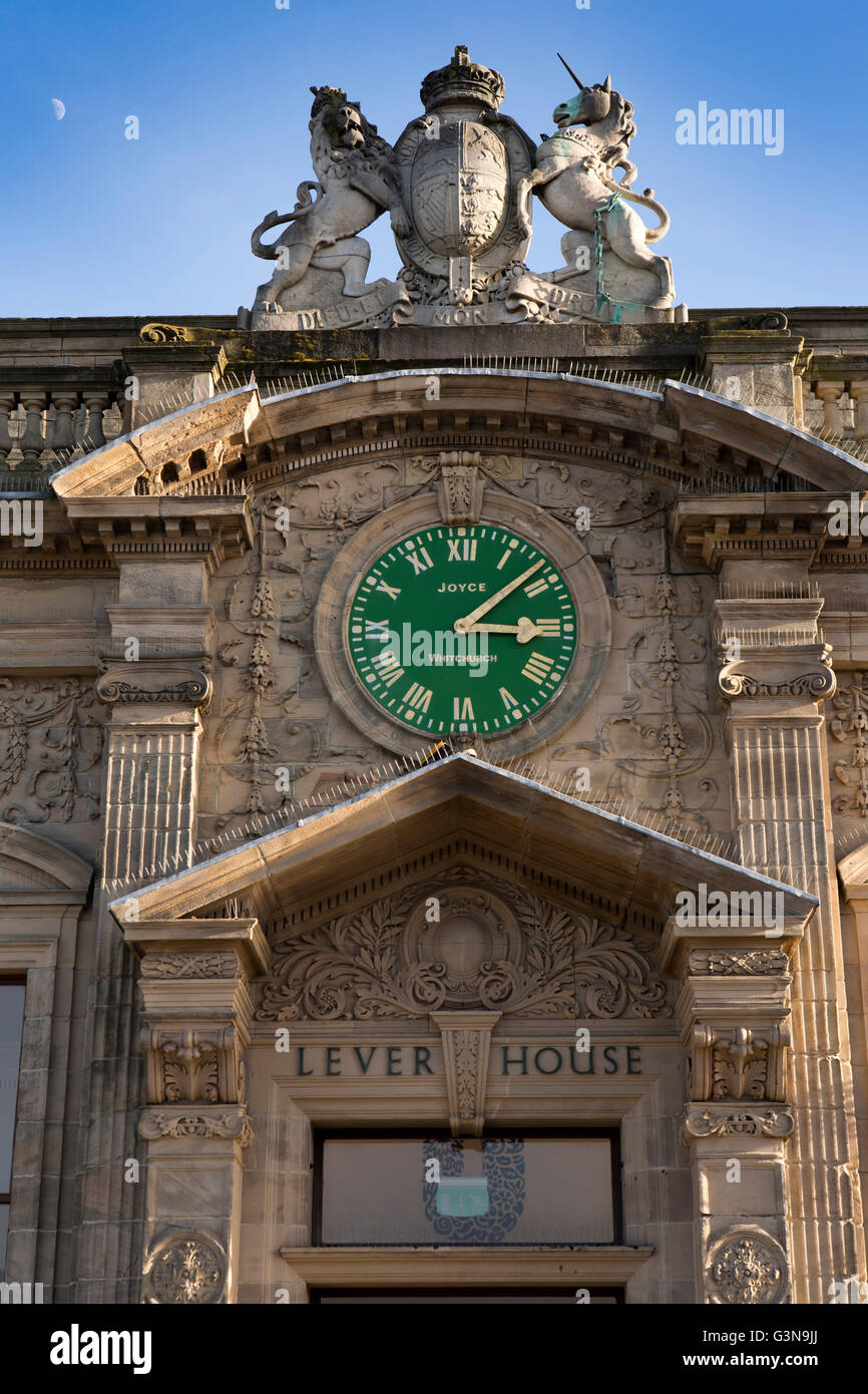 UK; England; Wirrall; Port Sunlight; clock and Royal Arms outside; entrance to Lever House; factory offices - Stock Image