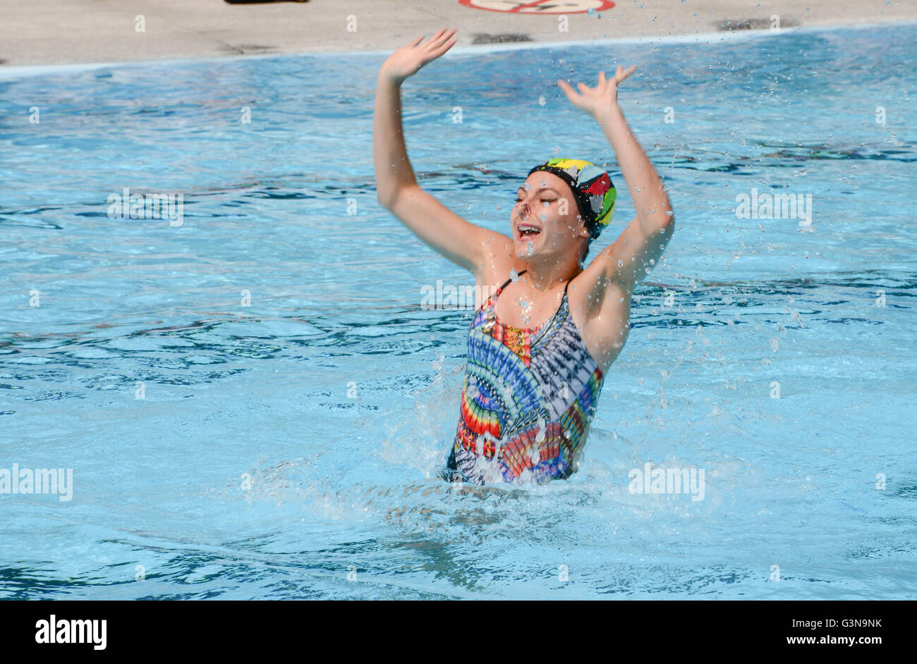 Massagno, Switzerland - 12 June 2016 - Girl in a pool practicing synchronized swimming Stock Photo