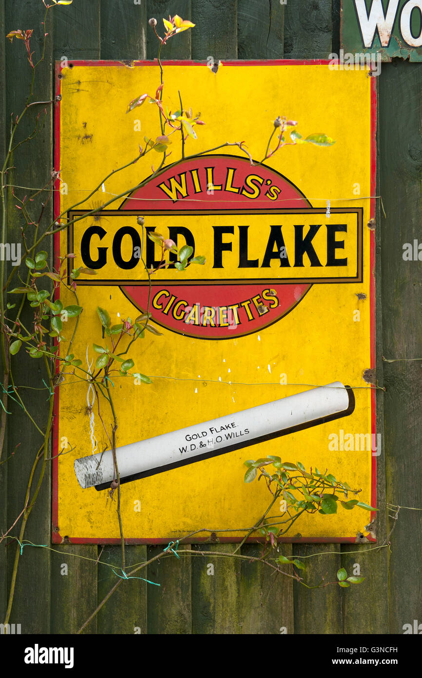 Vintage enamel advertising sign for Wills Gold Flake cigarettes - Stock Image