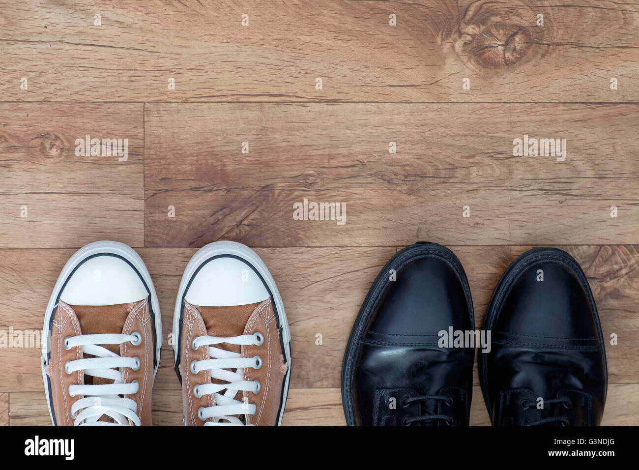 Sneakers and formal shoes - Stock Image