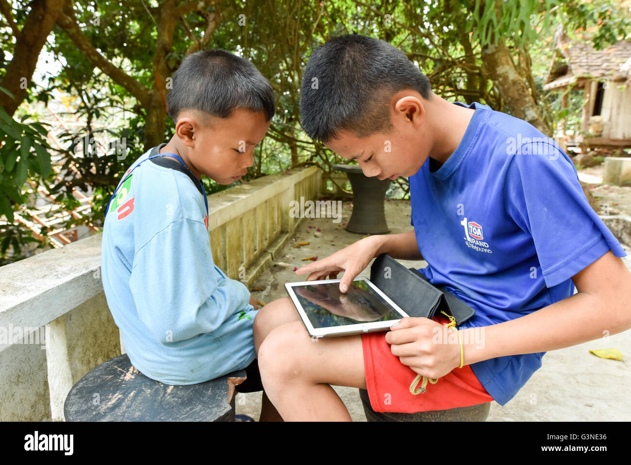 Children with tablet Laos - Stock Image