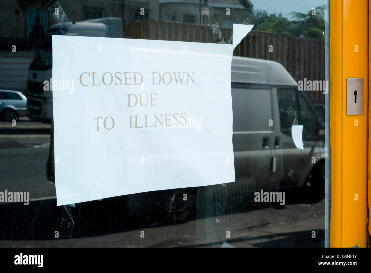 Closed down due to illness sign - Stock Image