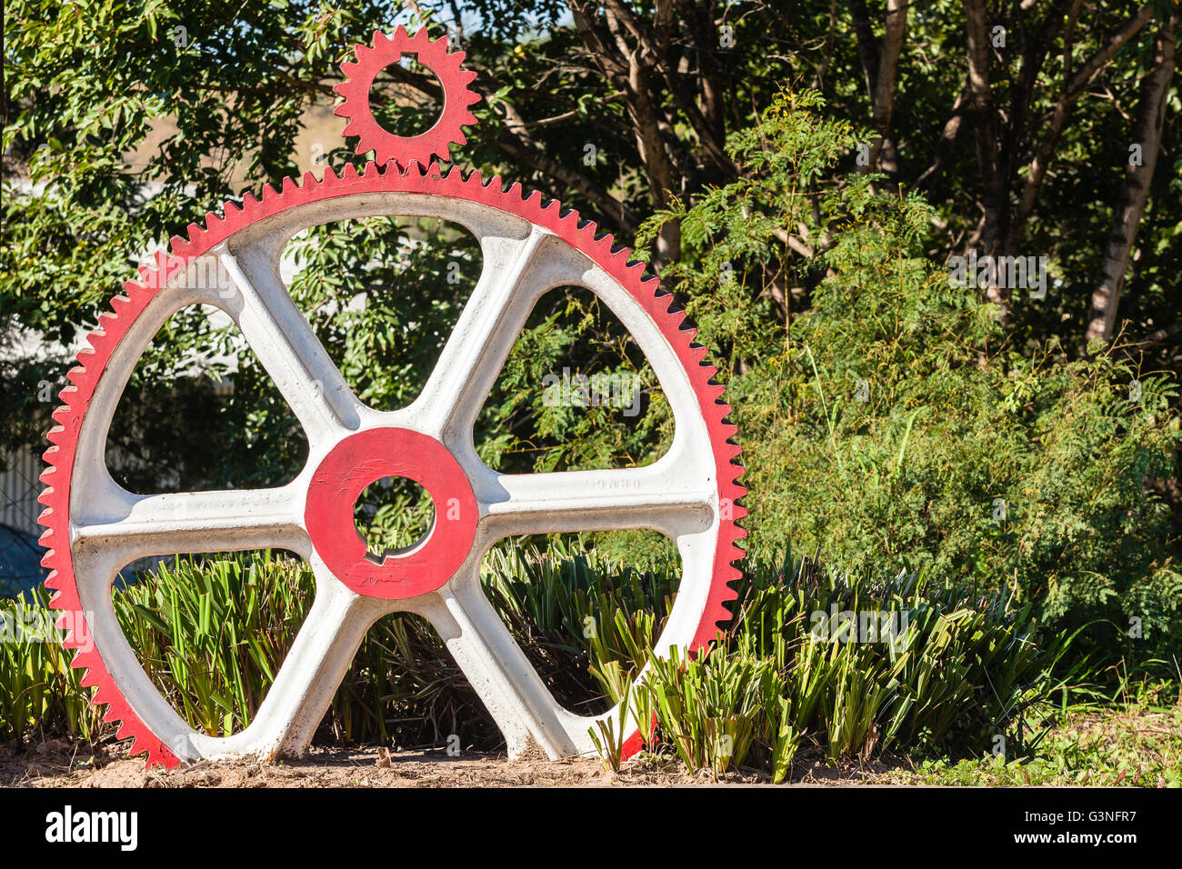 Wheel gears with drive gear sprocket outside engineering machining workshop - Stock Image