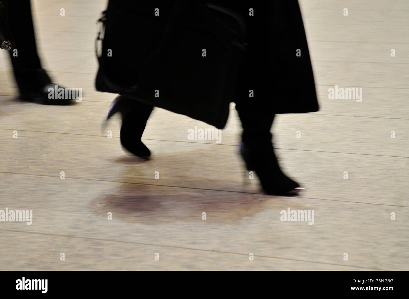 Abstract of formal woman walking with blurred motion - Stock Image